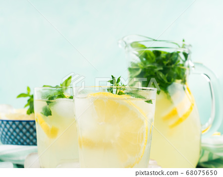 Fresh lemon lemonade in jug and glasses 68075650