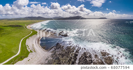 Aerial view of the beautiful coast next to Carrickabraghy Castle - Isle of Doagh, Inishowen, County Donegal - Ireland 68077594