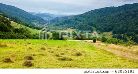 country road through rural field. suburban summer 68085193