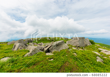 boulders on the alpine hillside. view from the 68085222