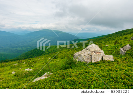 boulders on the alpine hillside. view from the 68085223