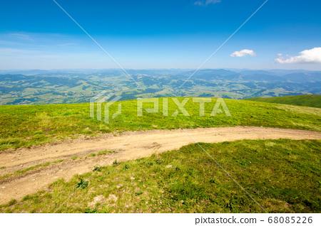 mountain road through grassy meadow. wonderful 68085226