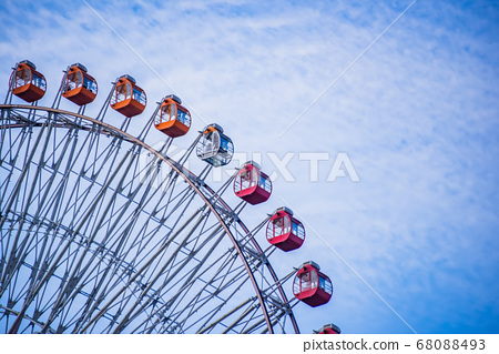 Partial view of a large ferris wheel with 68088493