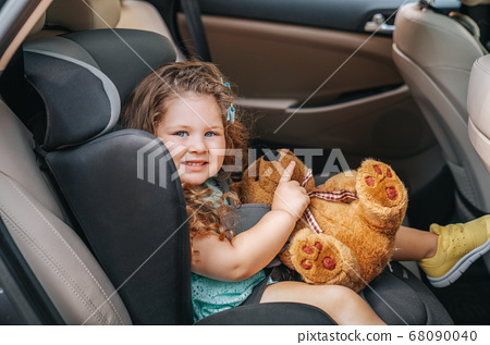 Cute little baby child sitting in car seat. Portrait of cute little baby child sitting in car seat.Safety concept. 68090040