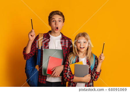 Excited Brother And Sister Raising Hands With Pencils Up, Having Idea 68091069