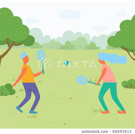 Girl and Guy Playing Badminton in Park on Meadow 68093613