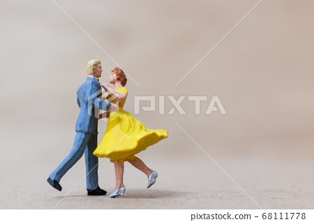 Miniature people , Couple dancing on wooden  background 68111778