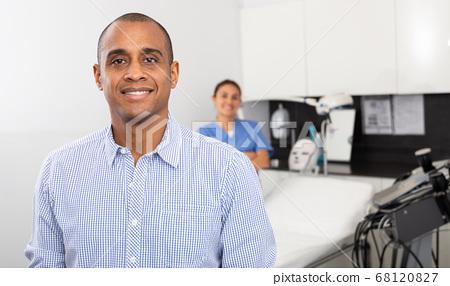 Happy male patient after procedure in aesthetic medicine office 68120827