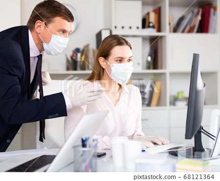 Man helping his colleague to prepare document on your computer 68121364