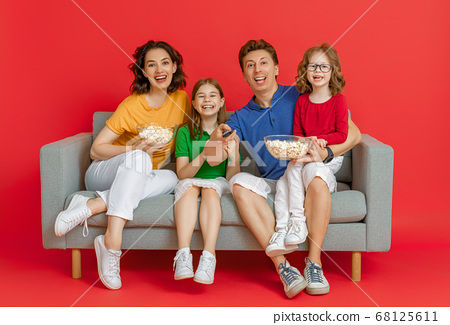 Happy loving family on bright color background. 68125611