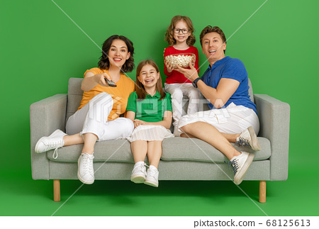 Happy loving family on bright color background. 68125613