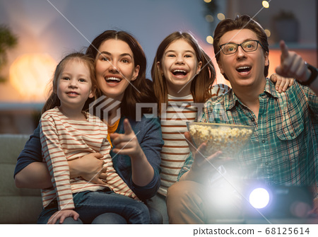 Mother, father and daughters spending time 68125614