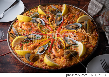 authentic paella on wooden board 68134264