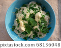 Homemade dumplings, traditional dumplings with meat, greens and cheese 68136048
