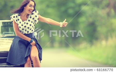 Beautiful woman seductively raises her skirt next 68166770
