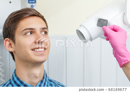 Dentist have made an x-ray of the tooth to patient 68189677