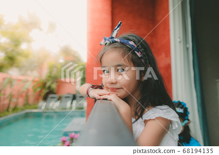 girl relaxing vacation holiday at the pool  68194135