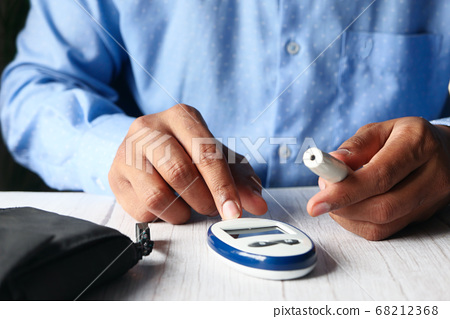 Top view of man hand measuring diabetic on table  68212368