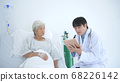 Medical concepts. The doctor is explaining the 68226142