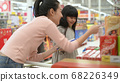 Shopping concept. Asian mother and daughter are 68226349