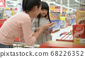 Shopping concept. Asian mother and daughter are 68226352