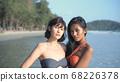 Travel concept. An Asian woman in a bikini is 68226378