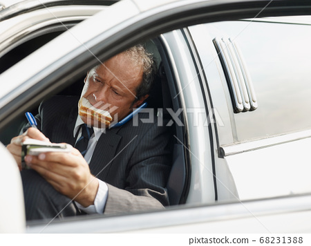 Driver Of White Limousine Eating Lunch Inside Car 68231388