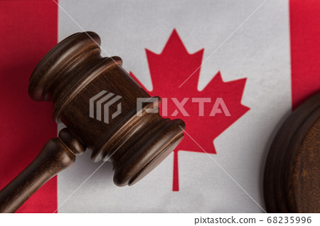 Judge gavel on Canada flag close up. Canadian 68235996