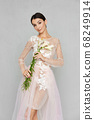 Pretty young woman in transparent tulle dress with 68249914