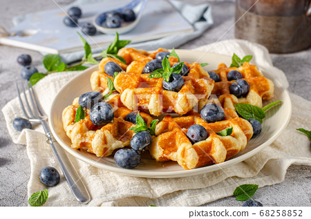 Homemade waffles with berries 68258852