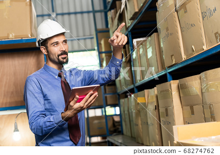 Middle east warehouse manager using tablet do 68274762
