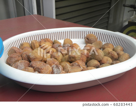 Plum nuts are dried for earth making 68283443