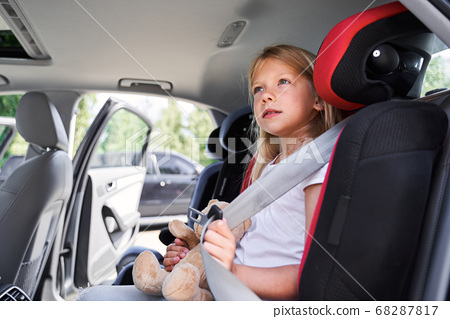 Pretty little kid ready for safe trip by car 68287817
