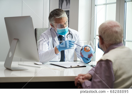 Elderly citizen visiting ophthalmologist for a quick eye check-up 68288895
