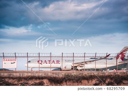 Phuket, Thailand - Feb 20, 2020: Qatar Airways Boeing 777 Airplane on Runway Track Preparation  68295709