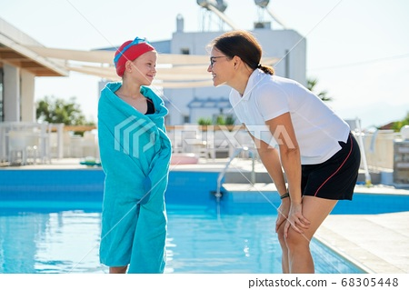Active healthy lifestyle, mother and daughter child near outdoor pool 68305448