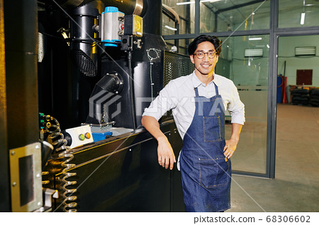 Barista at modern roaster 68306602