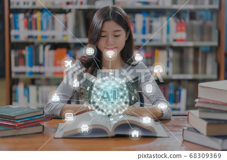 Polygonal brain shape of an artificial intelligence with various icon of smart city Internet of Things Technology over Asian young Student in casual suit reading the book in library of university 68309369