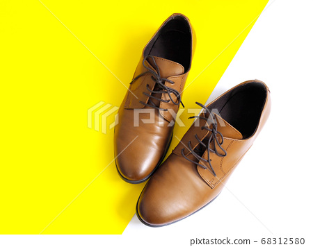 male brown leather shoe isolated on white and yellow colorful background 68312580