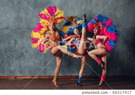Three Woman in cabaret costume with colorful feathers plumage 68317417