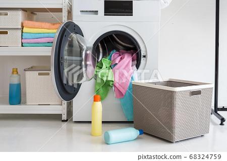 load laundry in washing machine, Housework 68324759