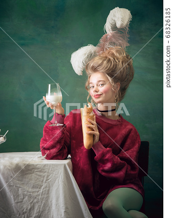 Young woman as Marie Antoinette on dark background. Retro style, comparison of eras concept. 68326185