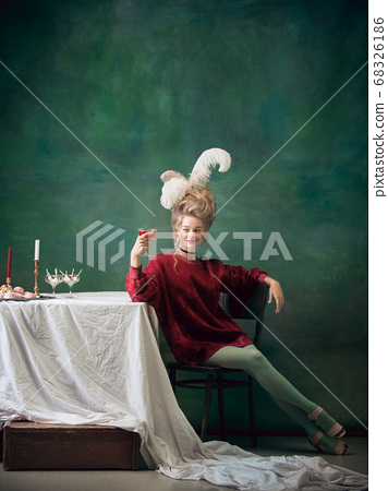 Young woman as Marie Antoinette on dark background. Retro style, comparison of eras concept. 68326186