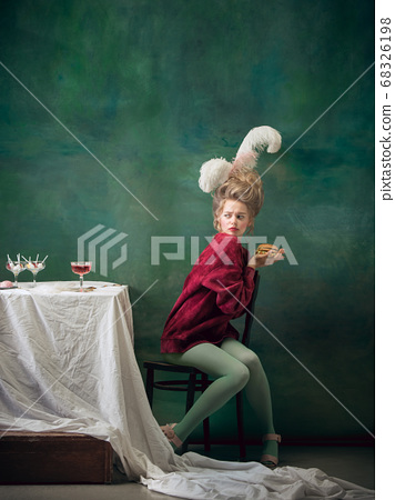 Young woman as Marie Antoinette on dark background. Retro style, comparison of eras concept. 68326198