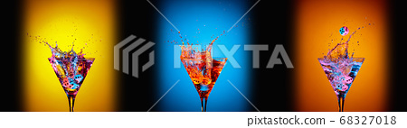 Dice fall in a glasses of martini. Colourful 68327018