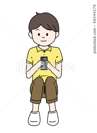 A relaxing boy with a smartphone 68344278