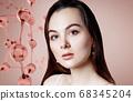 Beautiful young woman near big glass molecule structure. 68345204