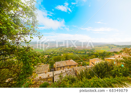 Blue sky over old roofs in Tuscany 68349879