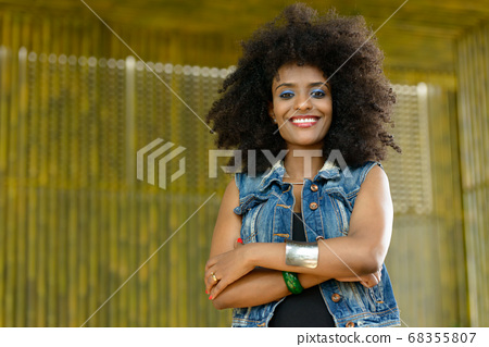 Happy young beautiful African woman with Afro hair outdoors 68355807