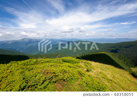 hills and valley of summer mountain landscape. 68358055